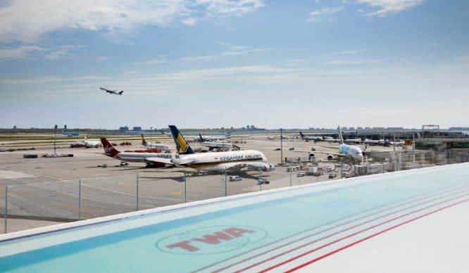 This Stunning Heated Rooftop Pool Overlooking The JFK Runway Is Open All Season Long • TWA Hotel