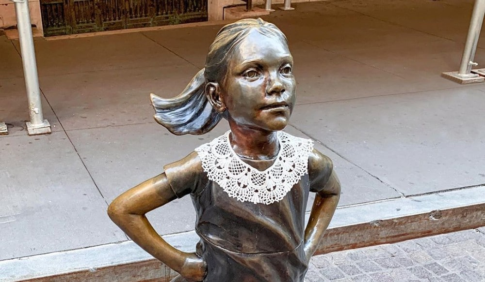A Lace Collar Has Appeared On Wall Street's Fearless Girl Statue As A Way To Honor RBG