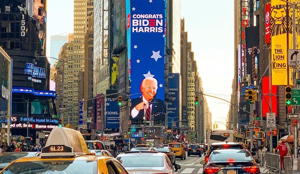Times Square's Iconic Screens Have Been Lit Up With Big 'Congratulations' To Biden & Harris