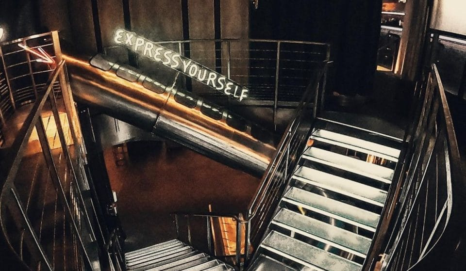 You Have To Ride Down A Gigantic 20-Foot Slide In Order To Enter This NYC Bar
