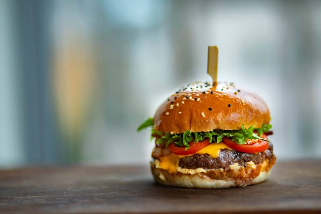photo-of-juicy-burger-on-wooden-surface-1639565