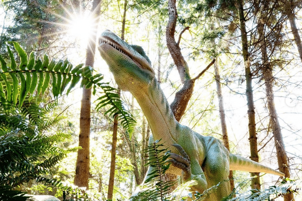 dinosaur under sunlight trees
