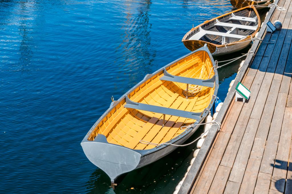 yellow white boat lake