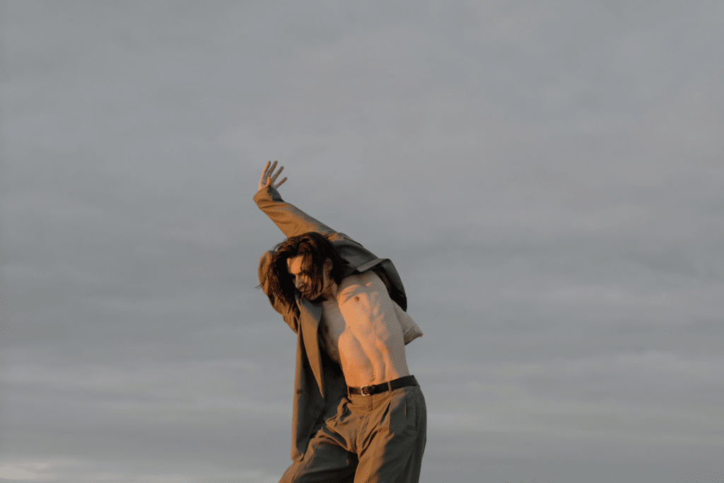 man dancing outdoors