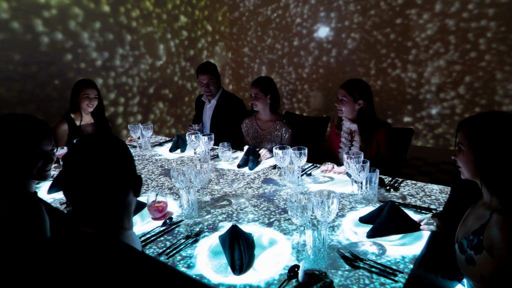 This Harbourside Restaurant's Projection-Mapped Dining Experience Is The Ultimate Vivid Sydney Feast